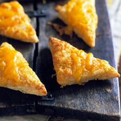 These Cheese Triangles will be a hit at your next get-together! More quick and easy party foods: http://www.bhg.com/recipes/party/appetizers/easy-party-foods/?socsrc=bhgpin063013cheesetriangles=21