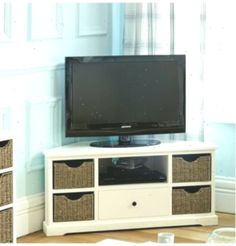 Could put baskets on shelves to dress up IKEA units like this: Cottage Ivory Cor… Source by ikea Bedroom Tv Unit Design, Tv In Bedroom, Basket Shelves, Baskets, Ikea Units, Corner Tv Unit, Living Room Decor, Ivory, Cottage