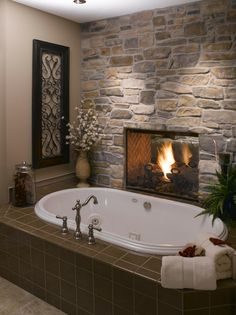 Fireplace between the master bedroom and tub. I would LOVE this!!