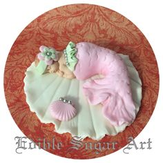 Fondant mermaid cake topper. Shell 4'' with fondant baby and accent shells. FAQ Please read prior to purchase. Thanks! :~) ~PLEASE allow 5-10 business days for your item to be made and shipped. ~All o
