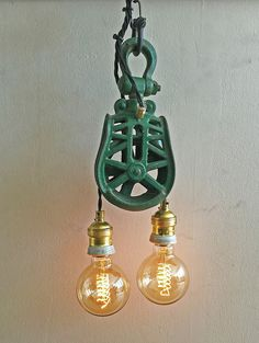 "Rusty Remakes Signature ""Philly"". Pendant lamp made from rusty green American pulley."