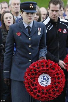 Scottish international rugby player and RAF Flt Lt Katherine Muir during the remembrance service at the Memorial Arch, Murrayfield, Edinburgh
