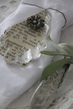 Jeanne d'Arc Livíng Blog--crystals treated with old book page and a bit of bling glued on.  Wonderful!