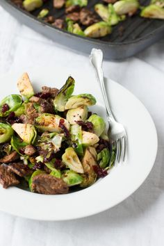 Steak and brussel sprouts recipe with a little juicy sweetness from pomegranate craisins! You have to try it to believe how yummy it is!