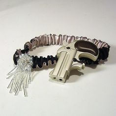 Wedding garter HE HAD it COMING  Steampunk prohibition costume burlesque lighter included. $36.00, via Etsy.