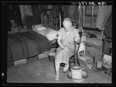 Member of Johnson family churning butter in her home near Black River Falls, Wisconsin 1937