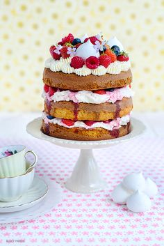 A pretty layer cake, bursting with summer flavours, berries, whipped cream, meringue and raspberry syrup   Supergolden Bakes