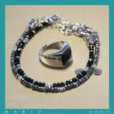 Bracciale in acciaio con pietre in onice nera, bracciale in acciaio con ematite e anello in acciaio con pietra centrale in onice nera della collezione #ManTrendy Stainless steel bracelet with black onyx stone, stainless steel bracelet with hematite, and steel ring with central black onyx. #ManTrendy collection