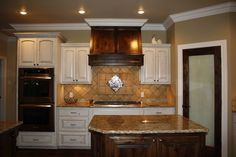 Blend of light and dark cabinetry!  www.johnjohsoncustomhomes.com #customhomes #lubbock