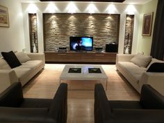 Great lighting idea for the front wall made of stone texture of living room.