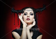 Beautiful Woman In Carnival Costume. Witch Shape With Horns. Stock Photo #halloween #halloweenimages