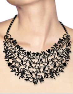 Necklace    Victoria Contreras Flores. She is a spanish designer and this is just one of her Literary (words) necklaces  here we see her 'Wearing the Wisdom of T.S Elliot.'