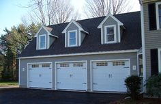 Steel Carriage House Garage Doors modern garage and shed