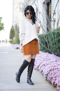 Cozy knitted lace up sweater with brown mini a line skirt and over the knee boots