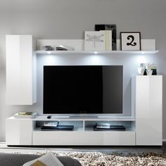 Die Wohnwand Mit Hochglanz Fronten Ist In Den Farben Weiss Oder Schwarz Bestellbar Modern Design Wohnzimmer