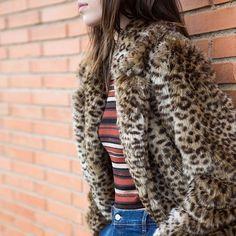 Faux fur coat & striped sweater.