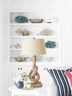 Lately I've been daydreaming about driftwood accents, a haze of navy blue linens, and gleaming white walls - put them altogether and this my curated home for a more uptight nautical interior. Wicker baskets are an instant coastal touch, especially when used for storage on shelving, and provide great contrasting elements on wood floors. Defined lines with each decor piece bring together organization of each space, and display each collection perfectly.