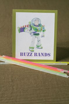 Toy Story Party :: Buzz Bands LOVE THIS  Perhaps great for a late evening theme? Gotta love this SoCal summer weather.