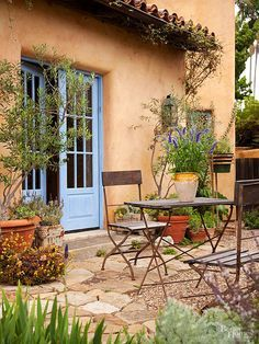 With flagstone, you can easily make an outdoor patio in a weekend -- no mortar required. Add potted plants and outdoor seating, such as a bistro set or an eclectic mix of colorful chairs, to create a quaint backyard escape.   See our outdoor furniture guide./