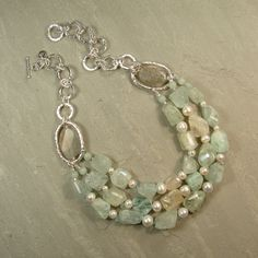 Sterling silver, triple row Aquamarine and cultured pearl necklace. £930.00, via Etsy.