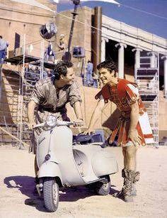 Sul set di Ben Hur: Charlton Heston e Stephen Boyd che spingono la VESPA. Ben Hur Charlton Heston, Ben Hur Movie, Ben Hur 1959, 1920s Gangsters, Bad Boy Entertainment, Stephen Boyd, Andre The Giant, New Line Cinema, Shocking Facts