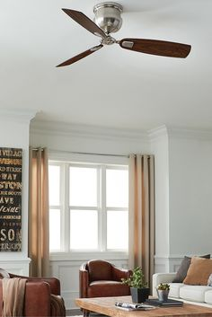 """Reminiscent of a vintage navy ship cannon, the robust housing of the 56"""" Cannondale ceiling fan by Monte Carlo mounts directly to the ceiling, and is well suited for a wide array of décor from industrial to nautical. The fan is designed for large rooms such as living or great rooms, master suites, or dining rooms."""