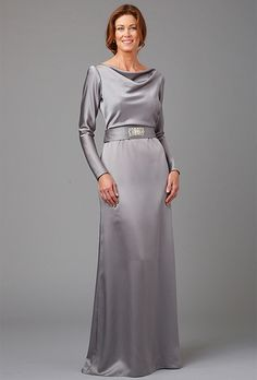 Brides: Siri. The Lincoln Center is sleek and stunning with fitted sleeves, cowl neck and a long, smooth skirt.