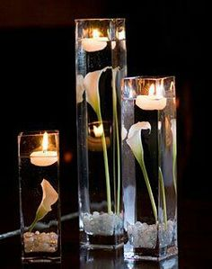 calla lily centerpiece with candles. use purple calla lillies Winter Wedding Centerpieces, Wedding Table, Wedding Decorations, Quinceanera Centerpieces, Graduation Centerpiece, Decor Wedding, Reception Table Decorations, Calla Lillies Centerpieces, Submerged Flowers