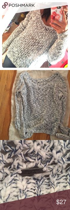 Abercrombie and Fitch sweater Abercrombie and Fitch sweater. Pretty blue and white mixed yarn material. Has pretty large holes in the stitching so would need a undershirt or tank top. Dress it up with dark jeans or down with black leggings. Abercrombie & Fitch Sweaters Crew & Scoop Necks