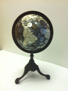 This button globe is on a side table in my office - Robin Ayres