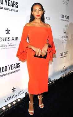 Solange from The Best of the Red Carpet  In this orange off-the-shoulder Milly dress, Solange turns heads at the Louis XII celebration of 100 Years: The Movie You Will Never See.