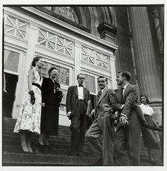 At the Met (Andy Warhol and Group of Unidentified People outside the Metropolitan Museum of Art, New York), 1953     gelatin silver print    8 1/4 x 8 in. (21 x 20.3 cm.)    The Andy Warhol Museum, Pittsburgh; Gift of Leila Davies Singelis    Photo © Leila Davies Singelis    1994.22.28.2