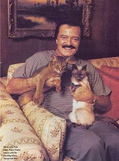 Robert Goulet loved cats since childhood.  When he toured the country as King Arthur in Lerner and Loewe's musical Camelot, he took along two of his cats - Vincent and Wart.  Several years ago, the cat-count in Goulet's Las Vegas home was up to seven.