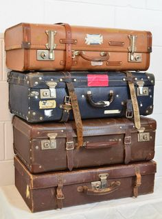 Heavy suitcases with straps, attached locks and things.