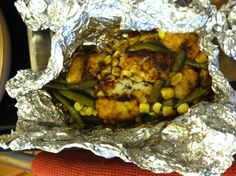 This foil packet recipe was given to me by my niece, and it is awesome! On a piece of foil with plenty of extra space to fold around it, 1 hamburger patty, frozen or raw, handful of tater tots frozen, handful of mixed vegetables frozen,  sprinkle brown gravy powder over it all ( be generous), fold up foil around food and cook over fire, grill, or in oven.    If you are from New Mexico, add cut up green chile before cooking too, or smother with red or green chile when done and add cheese!