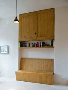 The settle and cupboard in the hallway were designed by Daykin Marshall Studio. The settle unfolds into a small bed. (Photo: Andrea Wyner for The New York Times)