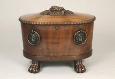 An antique English mahogany cellarette circa 1800