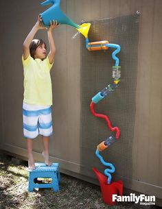 Play with Water: Looking for something a bit more engaging than running through the sprinkler? This wall-based (and drought-friendly) plaything lets kids arrange and rearrange the various repurposed bottles, funnels, and tubes, creating endless options for the cascade of water.