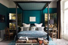 Pretty teal bedroom with canopy bed
