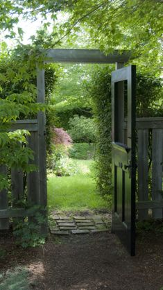 Love the idea of reusing an old door as a garden gate.