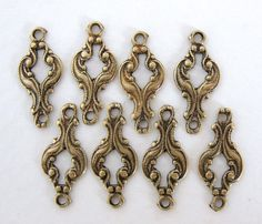 Antiqued Brass Ox Scroll Filigree Connector by BumbershootSupplies, $3.25