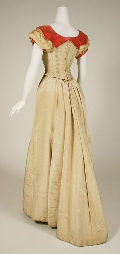 Evening dress Date: 1891–92 Culture: British Medium: silk Dimensions: Length at CB (a): 12 in. (30.5 cm) Length at CF (a): 14 1/2 in. (36.8 cm) Length at CB (b): 43 1/4 in. (109.9 cm) Length at CF (b): 40 1/2 in. (102.9 cm) Width at Bottom (b): 147 1/2 in. (374.7 cm)
