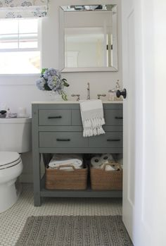 A few days ago, I shared a few of the projects I want to tackle in my  house. Top priority going to spaces that are used daily and need an  overhaul both in style and function. The first space I want to tackle in my  home for the New Year is my bathroom. Originally when we bought our home it  was a three bedroom one bathroom. While rebuilding our home due to a house  fire, we added a master bathroom and closet. That was the best decision  ever, especially now that our children are older and…