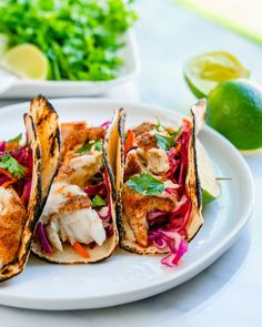 These tilapia fish tacos are a flavor-filled fast and easy dinner. Bake or broil the fish, then add sauce and slaw. A total crowd pleaser! | dinner recipes | healthy dinner recipes | tilapia recipes | tacos | mexican food recipes | fish recipes | seafood recipes | easy meals | pescatarian recipes | dairy free recipes | gluten free recipes | #tilapia #fishtacos #fish #tacos #tilapiatacos #easytacos Healthy Tuna Recipes, Tilapia Recipes, Baked Salmon Recipes, Healthy Food Options, Raw Food Recipes, Fish Recipes, Seafood Recipes, Mexican Food Recipes, Dinner Recipes