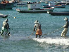 Fisherman netting their catch in Brazil