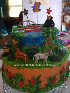 Homemade Jungle Birthday Cake: I made this Jungle Birthday Cake for my son Jacob's 1st Birthday! I bought a bunch of Jungle animals at our local zoo's gift shop. I made my cake using
