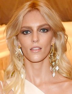Anja Rubik in Eddie Borgo custom earrings.  Just in case you ever looked up from her hip-bone high slit.