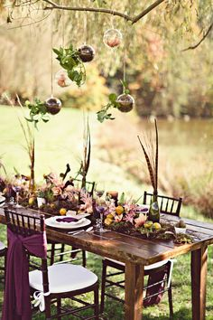 #rustic, #tablescapes, #farm-tables%0A%0APhotography: Almond Leaf Studios - almondleafstudios.com%0ADesign and Planning: Asheville Event Co - ashevilleeventco.com%0AFloral Design: Blossoms at Biltmore Park - blossomsatbiltmorepark.com%0A%0ARead More: http://www.stylemepretty.com/2013/03/20/bohemian-inspired-photo-shoot-from-almond-leaf-studios/