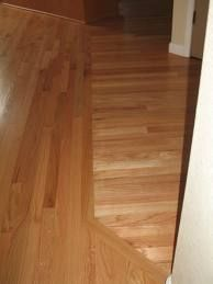 Transition between old wood floors and new old and new for Different flooring throughout house