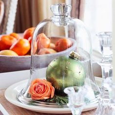 CHRISTMAS CLOCHE - A large ball ornament, a single rose and a few evergreen sprigs  - keep the rose watered with a florist's tube.